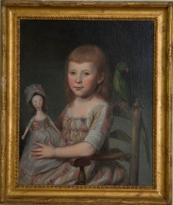 A potrait of a young girl named Ann Proctor holding a wooden Queen Ann doll.