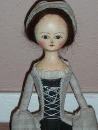 a vintage reproduction wood carved Queen Anne Style doll